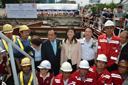Prime Minister Ms Yingluck Shinawatra of Thailand (centre) officiates at the start of metro tunnelling works
