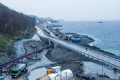 Contract E02 crushed rock conveyor passes under the state road for sea transportation away from site