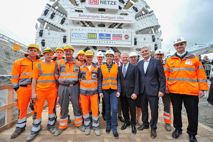 Deutsche Bahn officials and dignitaries join Porr workers at the launch ceremony