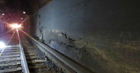 Severe longitudinal cracks and delaminated concrete in Hudson South tube bench wall