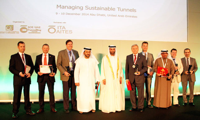 HE Essa Al Maidoor (centre) with award winners and presenters of technical lectures