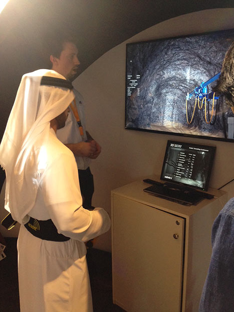At the controls of the shotcrete nozzle simulator on the BASF stand