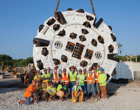 SKJV team members with the Robbins main beam TBM